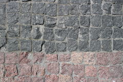 Rubble gray and brown square stones paved road. With a horizontal border Royalty Free Stock Image