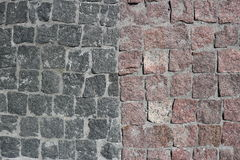Rubble gray and brown square stones paved road. With a vertical border Royalty Free Stock Photos