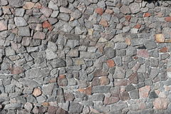 Rubble gray and brown stone wall, rubblework Royalty Free Stock Photo