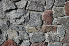 Rubble gray and brown stone wall, rubblework Stock Images