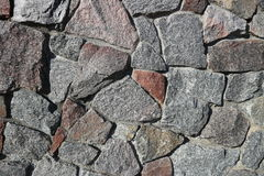 Rubble gray and brown stone wall, rubblework Stock Image