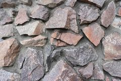 Rubble gray and brown stone wall, rubblework.  Stock Photos