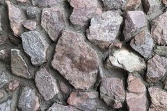 Rubble gray and brown stone wall, rubble work.  Royalty Free Stock Photos