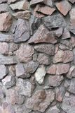 Rubble gray and brown stone wall, rubble work.  Stock Photo