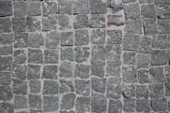 Rubble gray square stones paved road Royalty Free Stock Photography