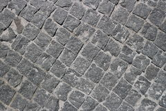 Rubble gray square stones paved road Royalty Free Stock Image