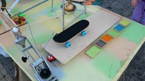 Rube Goldberg Machine. Skateboard launches a ball