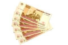 100 Rubel ein Fan auf einem weißen Hintergrund Stockfotografie