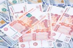 Rubel och dollar Arkivbilder
