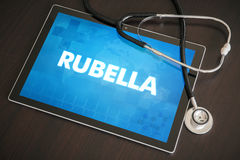 Rubella (infectious disease) diagnosis medical concept on tablet. Screen with stethoscope Stock Photos