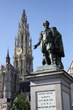 Rubens statue in Antwerp. Statue of Peter Paul Rubens in the city of Antwerp (Antwerpen), Belgium, with the clock tower of the Cathedral of Our Lady in the Royalty Free Stock Photography