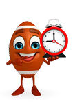 Rubgy ball character with table clock Royalty Free Stock Image