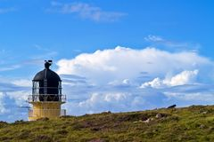 Rubha Reidh Lighthouse with storm clouds Royalty Free Stock Photos