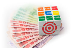 Rubick's Cube of target over thai money Stock Photos