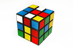 Rubik Cube. Colorful and world famous Rubik's cube in a scrambled state on a white background Stock Image
