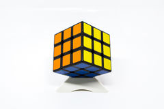 Rubik cube successful orange yellow blue with stand Royalty Free Stock Photo