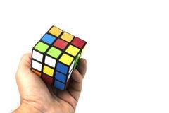 Rubik della tenuta della mano Fotografie Stock
