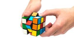 Rubik s立方体在手中 库存图片