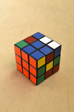 Rubik's Cube. In the assembly process on the table Royalty Free Stock Photo