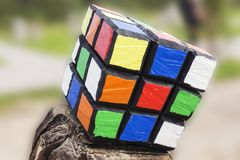 The Rubik`s cube on blurred background. Rubik`s cube was invented by Hungarian architect Erno Rubik in 1974. Stock Photo