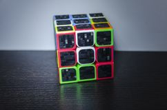Rubik`s cube on the dark table stock images