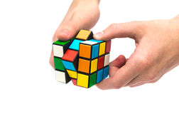 Rubik s cube in hand Stock Image
