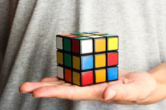 Rubik's Cube in hand Royalty Free Stock Images
