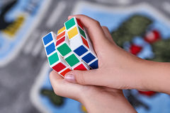 Rubik's Cube are in the hands of Stock Image