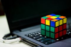 Rubik`s cube on laptop. techincal and business solving problem royalty free stock images