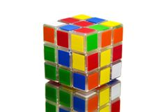 Rubik's cube. Rubiks cube on white background and reflective surface royalty free stock images