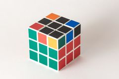 The Rubik`s cube on the white background. The solution sequence stage five. The object is isolated on white and a clipping path is provided for easy extraction Royalty Free Stock Photos