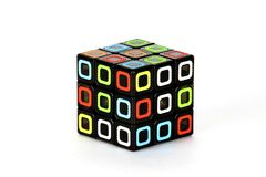 The Rubik`s cube on the white background. The solution sequence stage one, beginig. The object is isolated on white and a clipping path is provided for easy Stock Photos