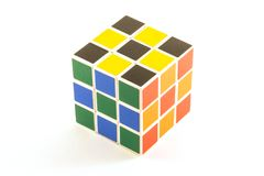 The Rubik`s cube on the white background. The way of solution. The object is isolated on white and a clipping path is provided for easy extraction Stock Photography