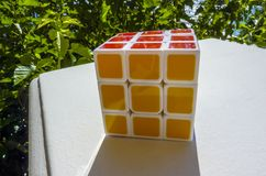 Rubik's Cube. On a white stone table Royalty Free Stock Photography