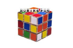 Rubik's fun text on cube. Rubik's fun text on the cube and white background stock photo