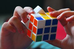 A Rubik`s Games is in a hands Stock Photos