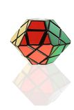 Rubik's icosahedron. Puzzle on the white background with reflection Royalty Free Stock Images