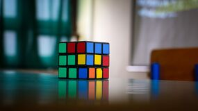 Rubik's cube on table Royalty Free Stock Photo