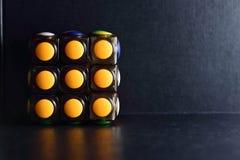 Rubikkubus op donkere achtergrond Stock Foto's