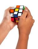 Rubiks cube. Hands playing a cube game Stock Photography