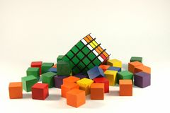 Rubiks cube. And colored blocks over white background Royalty Free Stock Photos