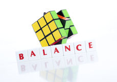 RUBIK'S CUBE AND BALANCE LETTER PIECES Stock Photos