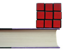 Rubiks Cube on Book Royalty Free Stock Images