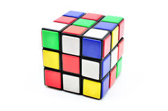 Rubiks kub på vit bakgrund Arkivfoton