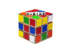 Rubiks text message on cube. And white surface background stock photography
