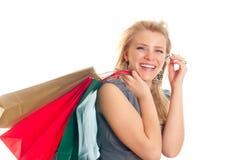 Rubio encantador con los bolsos de compras Fotografía de archivo