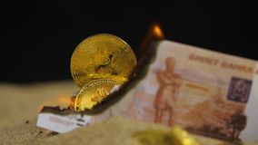 Ruble Banknote Burns Opens View on Coins Heap