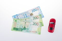 Ruble banknotes and red toy car, Russian currency on a white background. concept of shopping or sales.  royalty free stock photography