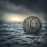 Ruble coin sinking in water Stock Photography