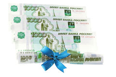 Ruble with gift bow Royalty Free Stock Photography